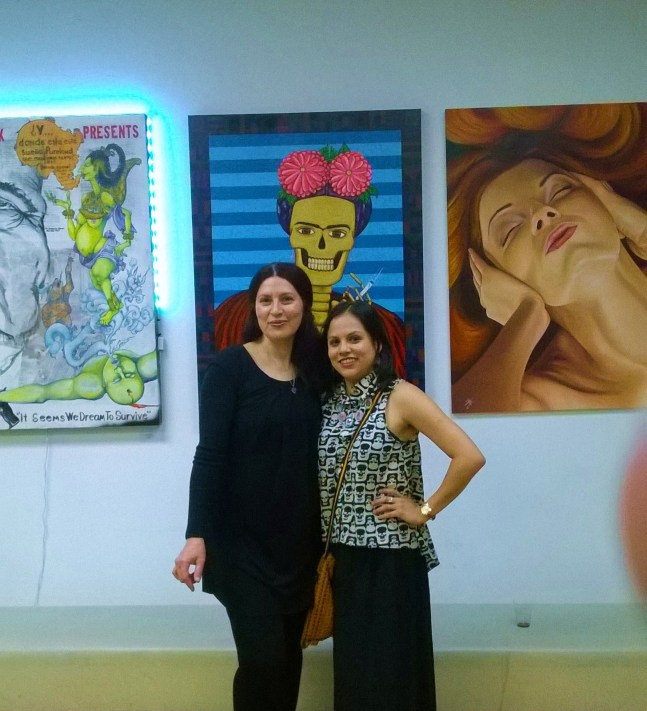 Artist Mayra Zamora and myself in front of some of her paintings.
