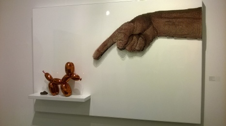 Pointing a finger: a nod to Koons?